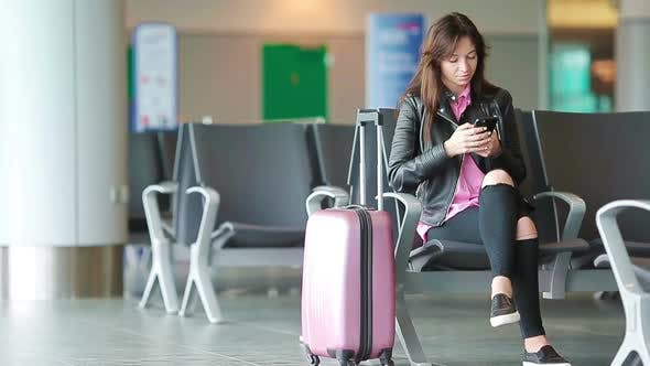 Thumbnail for Airline Passenger Girl in an Airport Lounge Waiting for Flight Aircraft. Caucasian Woman with