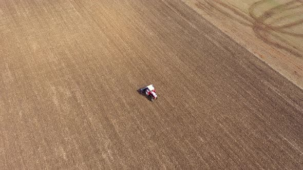 Thumbnail for Flying Above a Tractor Plowing the Field