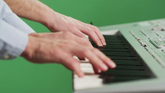 Thumbnail for Side view of a man playing the keyboard