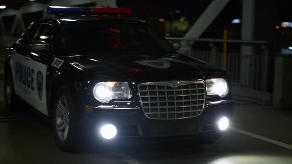 Police Vehicle Driving on Bridge