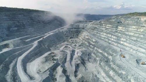 Aerial view of explosion smoke in Huge asbestos quarry 15