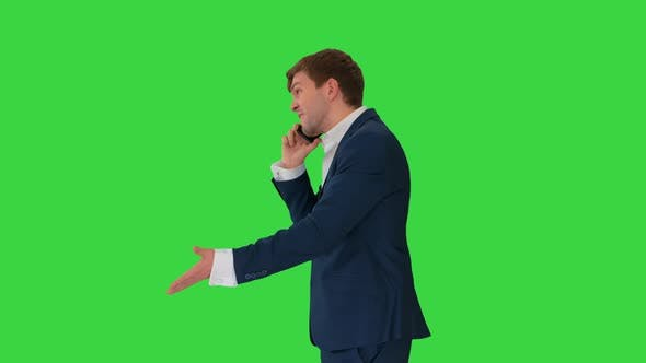 Thumbnail for Stressed and Angry Businessman Talking on the Phone on a Green Screen, Chroma Key.