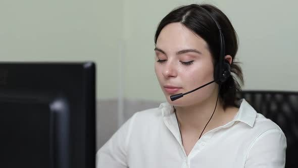 Thumbnail for Office worker talks with a client on the phone