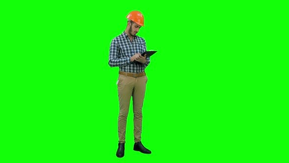 Cover Image for Site Inspector Filing in Inspection Form on a Green Screen, Chroma Key