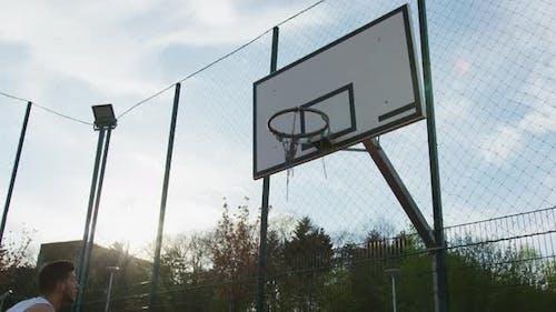 Ball missing the basketball hoop