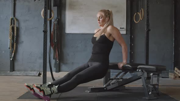 Thumbnail for Woman Doing Triceps Bench Dips in Gym