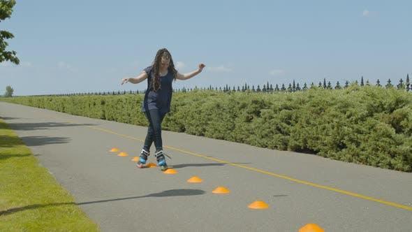 Thumbnail for Roller Riding Crisscross Through Cones in Park
