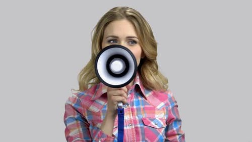 Happy Young Woman Giving Speech with Megaphone