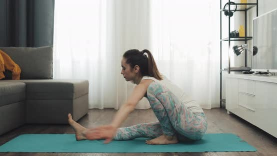 Cover Image for Young Woman Doing Yoga at Home. Healthy and Sport Lifestyle.