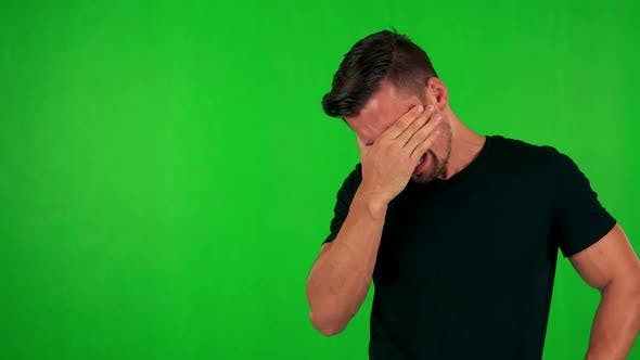 Thumbnail for Young Handsome Caucasian Man Cries  - Green Screen - Studio