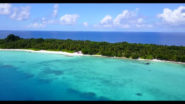 Thumbnail for Aerial seascape of idyllic seashore beach adventure by blue sea and white sandy background of a dayo