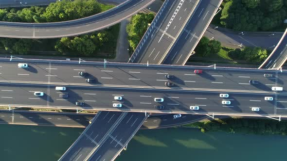 Thumbnail for Aerial Drone View of Highway Multilevel Junction Road with Moving Car at Sunset