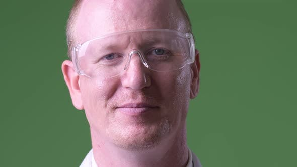 Thumbnail for Happy Mature Bald Man Doctor Wearing Protective Glasses