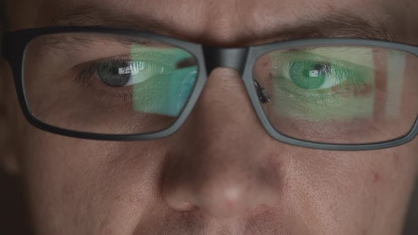 Thumbnail for Reflection Of Scrolling Sites In An Eyeglasses Of Young Adult Man In A Dark Room