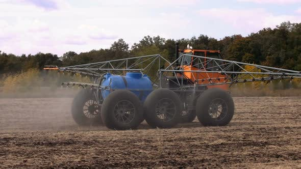 A Machine for Irrigating the Land Works in a Field