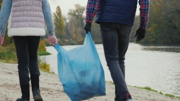 Thumbnail for Children Volunteers Carry a Bag of Garbage, Go Along the Shore of the Lake Where They Collected