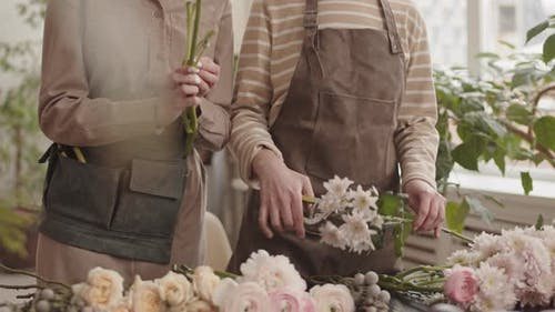Cropped Florists Trimming Flowers
