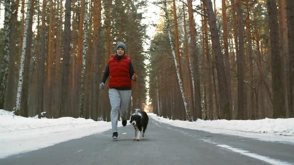 Thumbnail for Woman Jogging with Border Collie Dog