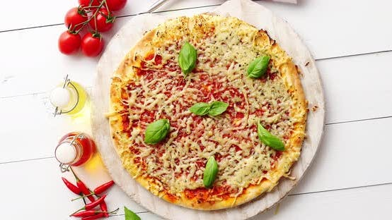 Thumbnail for Delicious Italian Pizza Served on Wooden Table, Shot From Above