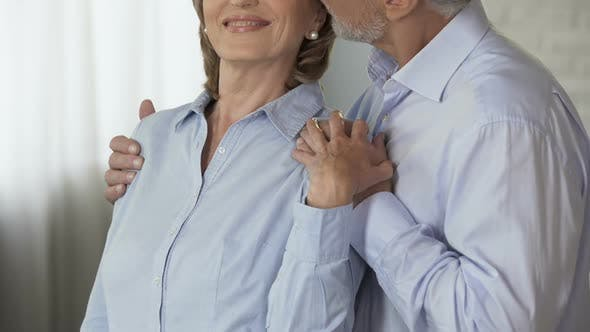 Thumbnail for Senior Man Taking Woman by Shoulders from Behind, Kissing Her on Head, Loving