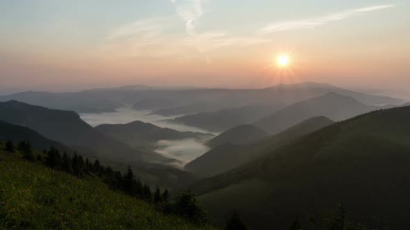 Thumbnail for Sunrise in Mountain Valley Time Lapse. Mist Foggy Morning