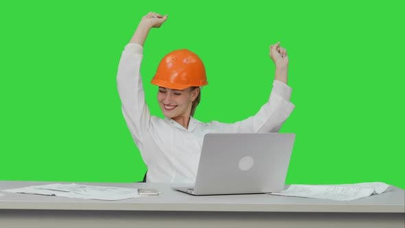 Thumbnail for Female Chief Engineer Celebrate a Successful Finish of Project Smiling on a Green Screen Chroma