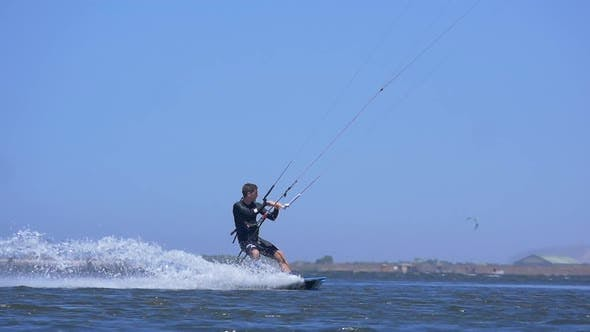 A man kiteboarding on a kite board.