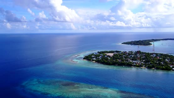 Tropical drone travel shot of a sandy white paradise beach and blue sea background in colourful 4K
