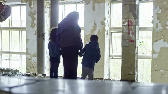 Thumbnail for Muslim Woman with Children in Abandoned Building