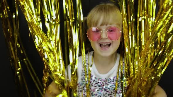 Thumbnail for Happy Child Jumping, Playing, Fooling Around in Shiny Foil Fringe Golden Curtain. Little Blonde Kid