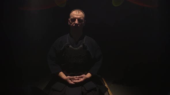 Thumbnail for Athletic Kendo Guru Sitting on the Floor with Closed Eyes