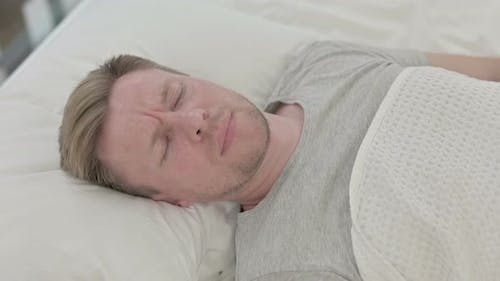 Man Waking Up From Nightmare