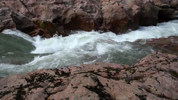 Mountain river among granite stones