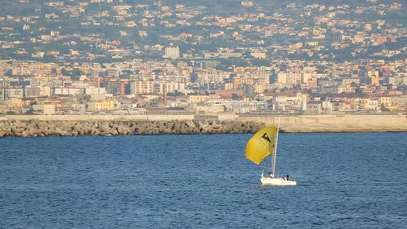 White Yacht with Yellow Sail Floating Near Gulf of Naples, Water Transportation