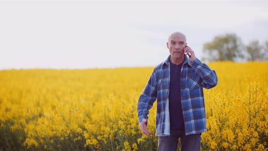 Thumbnail for Angry Male Agronomist Talking Through Cellphone On Rapeseed Field