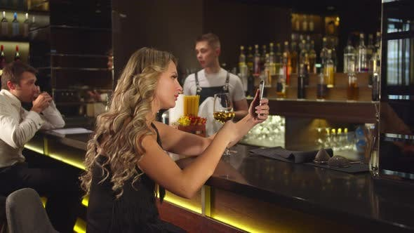 Thumbnail for Woman Drinks Alcohol and Talks By Video Link on the Phone