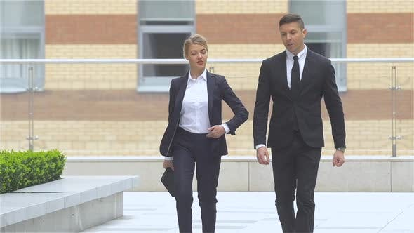 Thumbnail for Businessman and Businesswoman Walking on the Street of an Business Center, Slow Motion