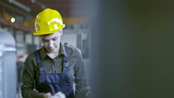 Thumbnail for Young Factory Employee Working with Colleagues