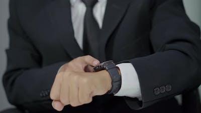close up hand of business man using smart watch