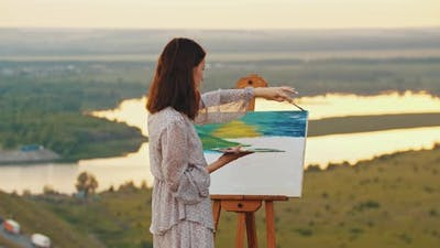 Young Woman Drawing a Painting on Nature  Drawing Blue Sky with Oil Paints