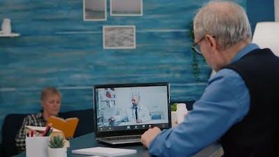 Remote Doctor Using Webcam Prescribing Medicine to Sick Aged Man