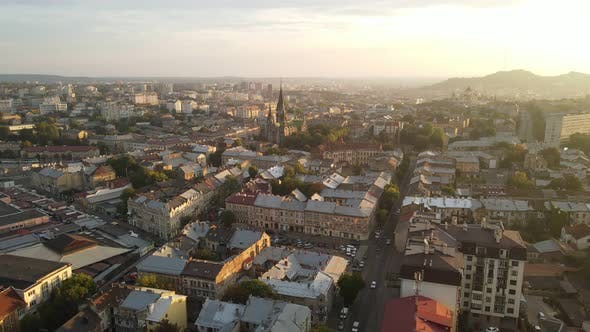 Thumbnail for Aerial Flight on a Fabulous City at Sunrise. Morning in the Small Town of Lviv in Ukraine. The Sun's