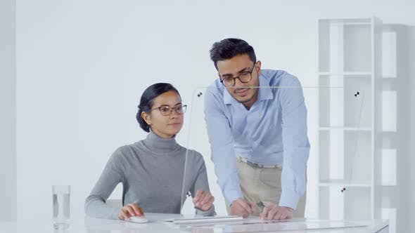 Cover Image for Coworkers Using Invisible AR Interface and Communicating