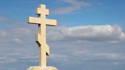 Christian Cross on Grave Stone, Peaceful Blue Sky Background, Religion, Church