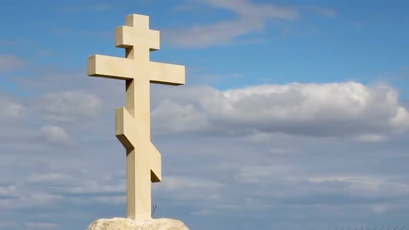 Thumbnail for Christian Cross on Grave Stone, Peaceful Blue Sky Background, Religion, Church