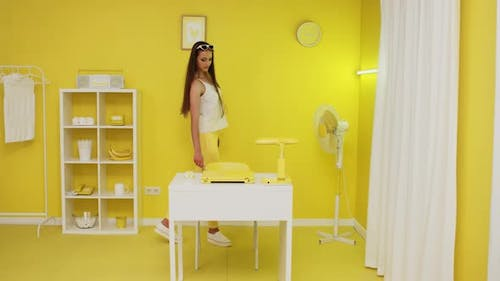 Stylish Lady Is Cleaning Yellow Room