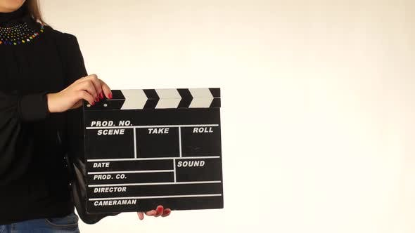 Thumbnail for Woman Uses Movie Clapper Board, on White
