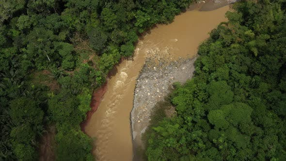 Aerial still video of a fast flowing tropical river in the Amazonian rainforest of south america