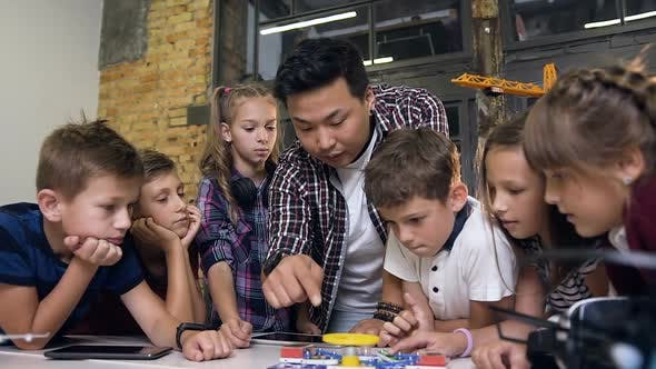 Thumbnail for Creative Children with Teacher Launching Electronic Constructor with Fan and Turning Flashlight