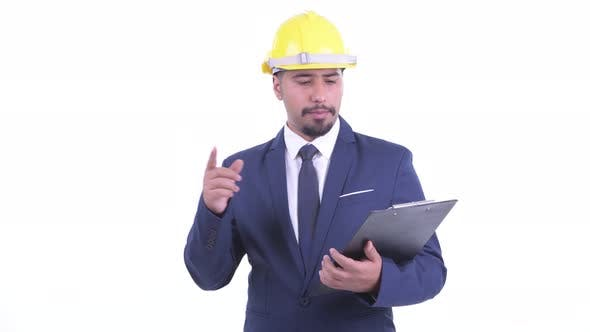 Thumbnail for Happy Bearded Persian Businessman As Engineer Talking While Holding Clipboard